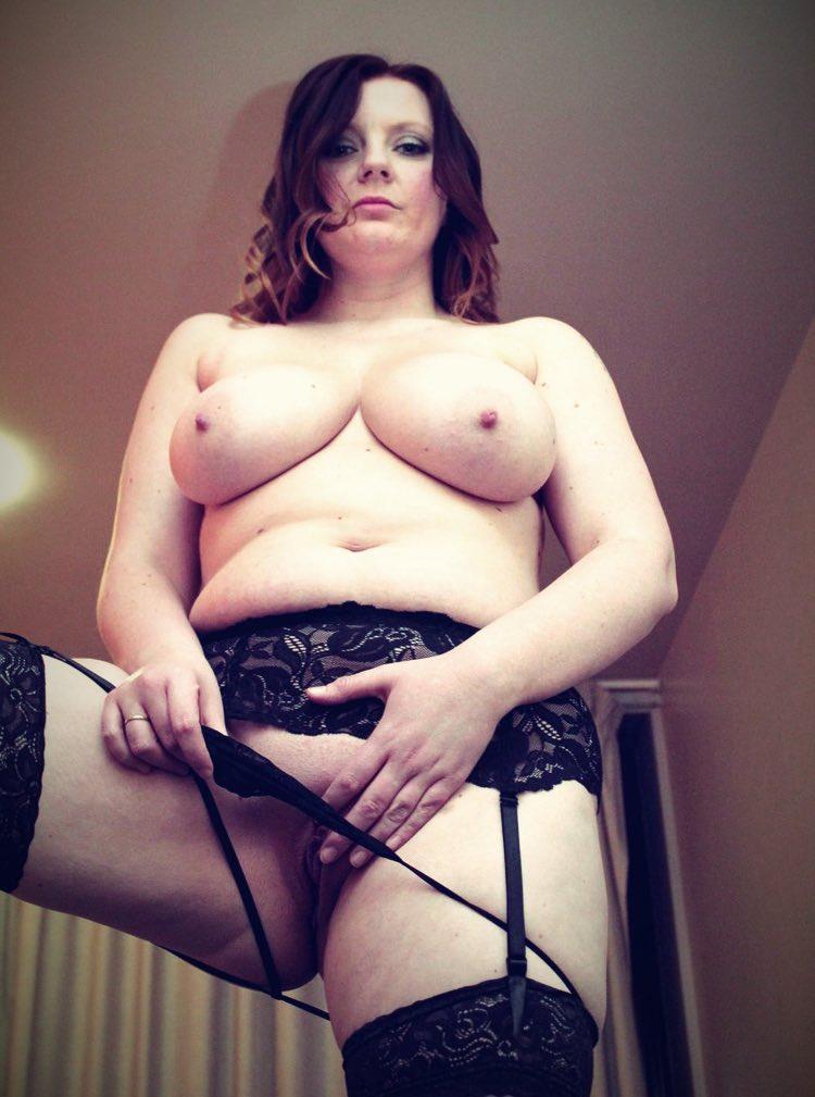 A big pig shows off her big breasts